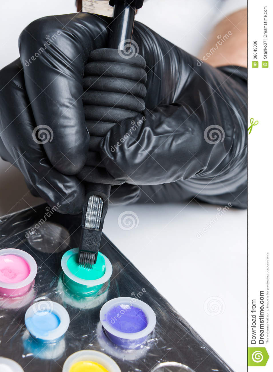 Hand holding tatttoo machine gun royalty free stock photos for How to put ink in a tattoo gun