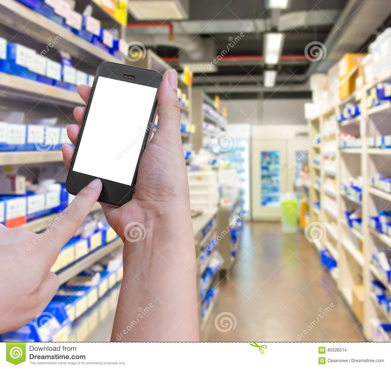 Hand holding and Touch on smartphone mobile with in pharmacy o