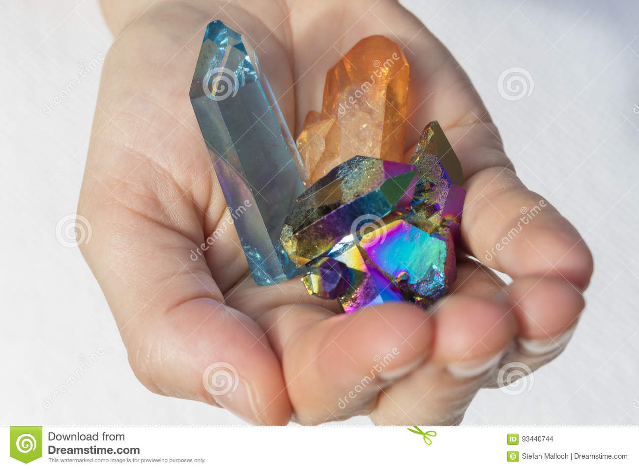 Download Hand Holding Various Aura Crystals Stock Photo - Image of amber, black: 93440744