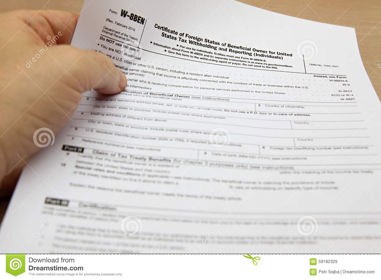 Download A Hand Holding The W-8BEN Form Stock Image - Image of bureaucracy, financial: 59182329