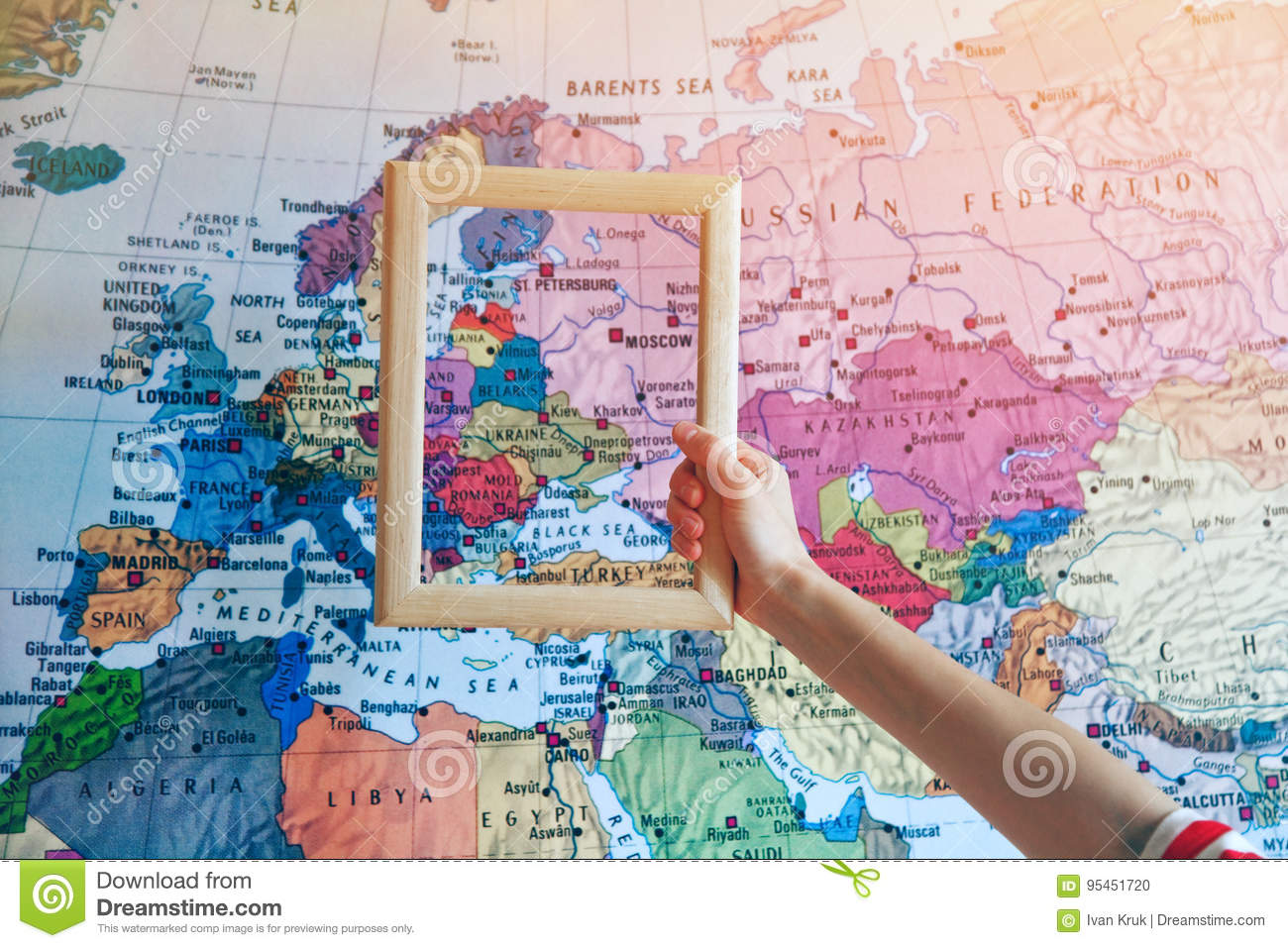 Hand Holding Wooden Frame On Europe Map Stock Photo - Image of frame ...