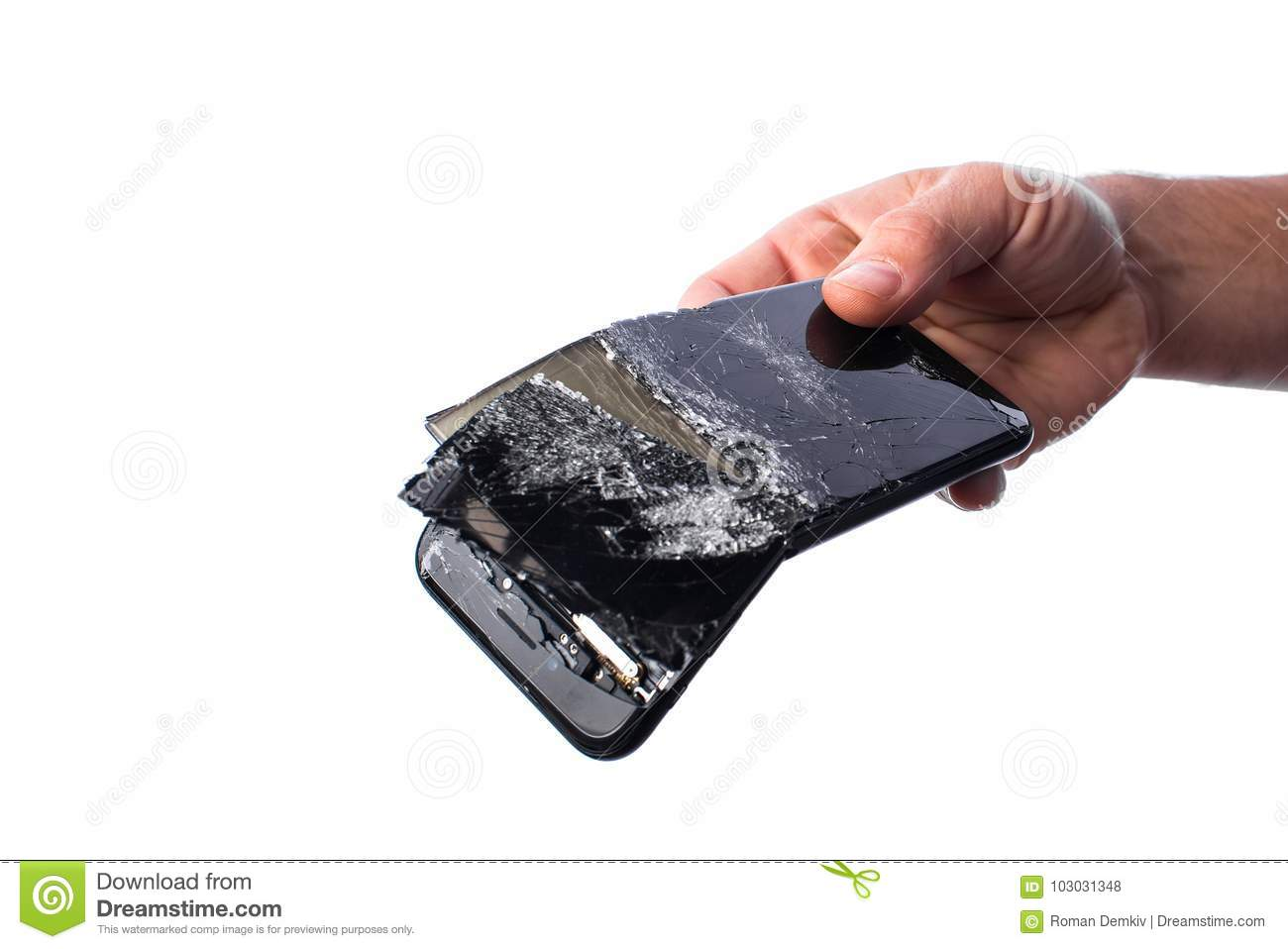 Hand holds a broken mobile phone, a white background, a business concept