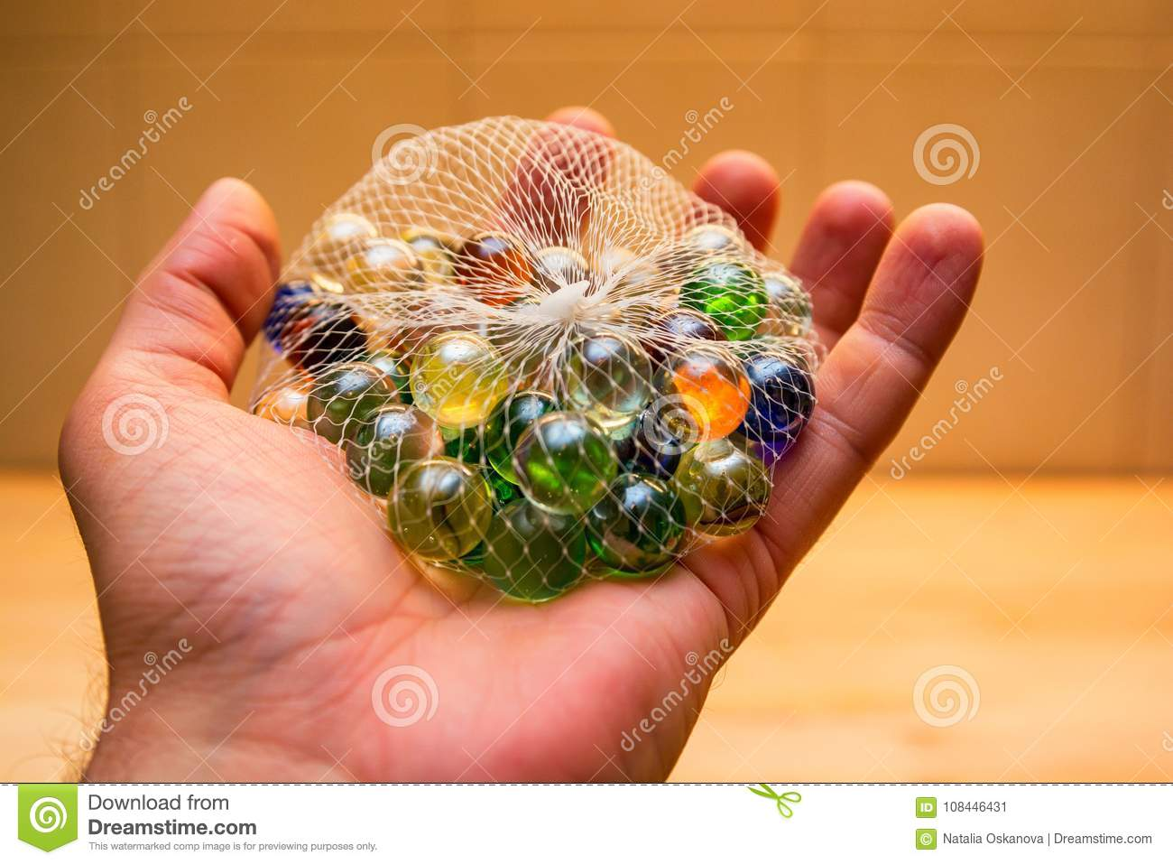 Hand Holds Colorful Glass Marbles In Net Stock Image Image Of