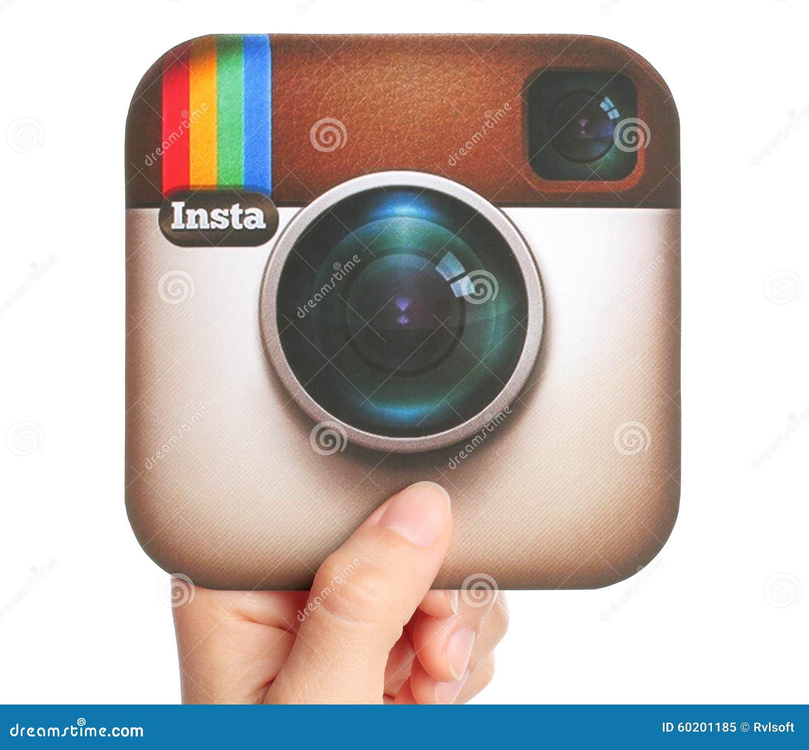 Hand holds Instagram logotype