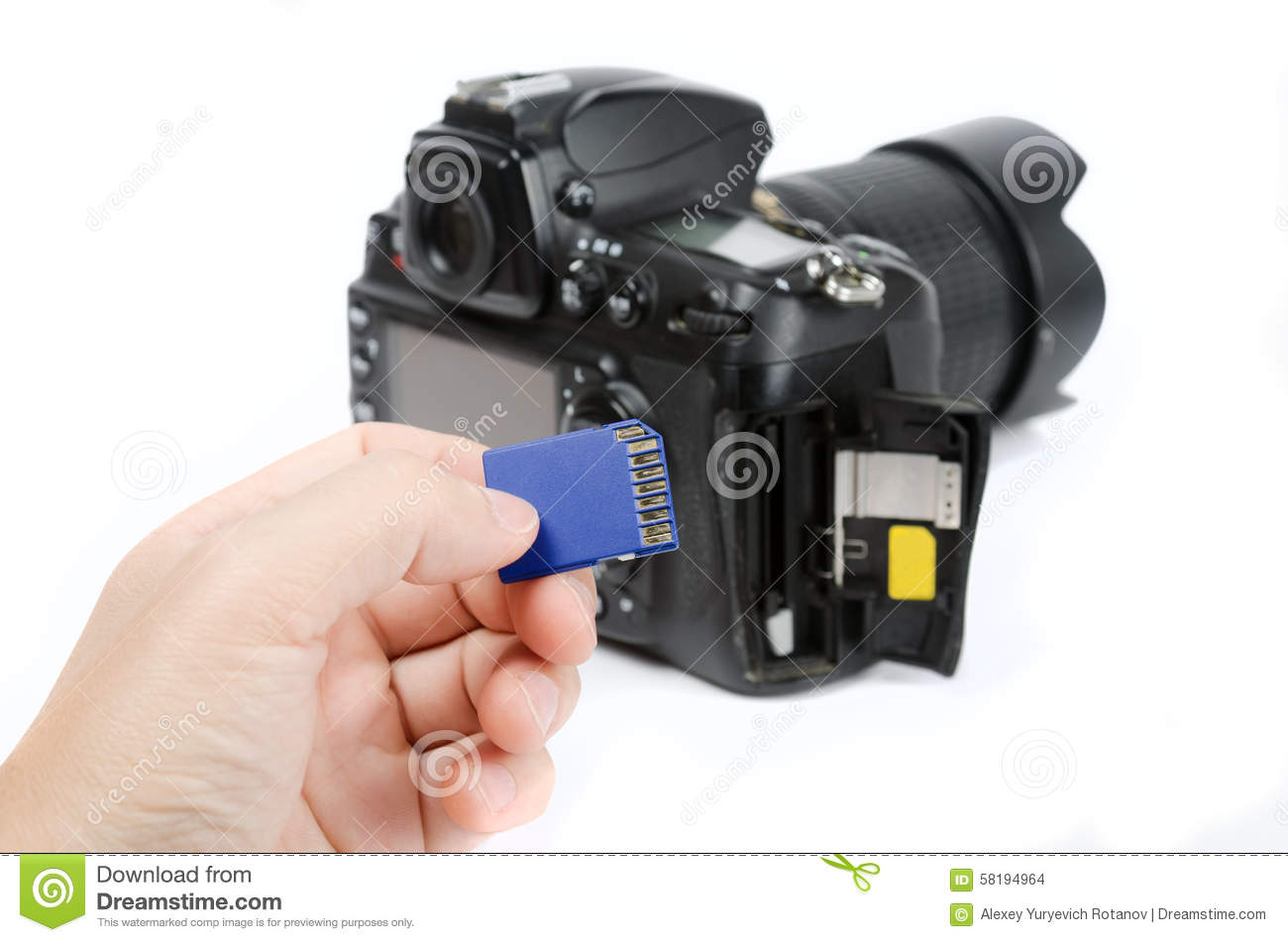 Camera Memory Cards For Dslr Cameras hand holds sd memory card with dslr camera on the background stock background
