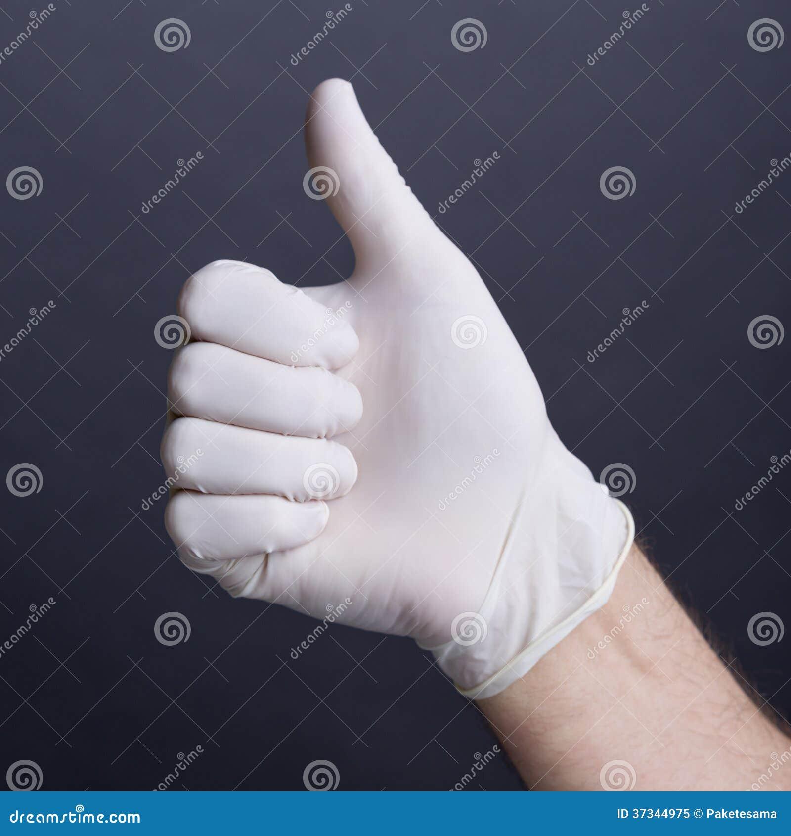 Hand i latexhandskar, övre gest för tumme