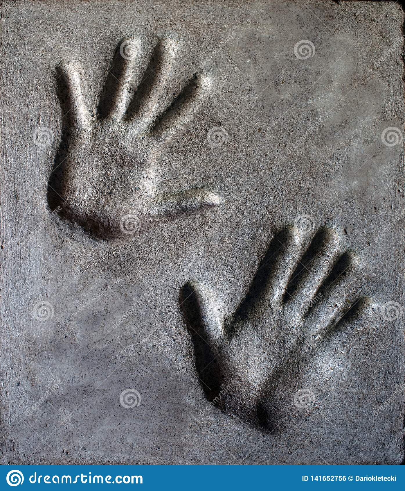 Hand imprint in mortar.