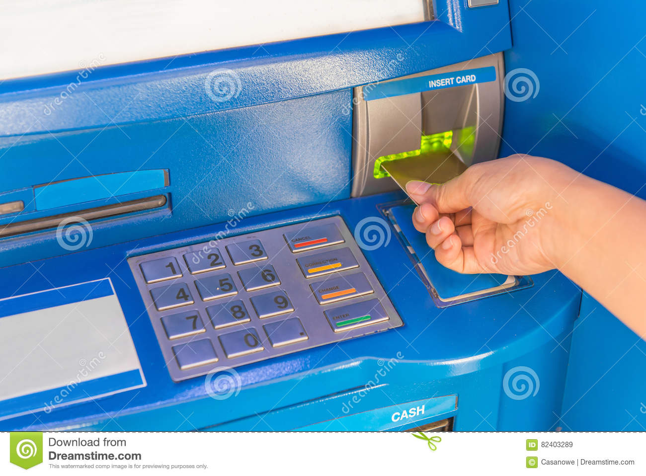 Hand insert credit card to ATM bank cash machine for withdraw mo