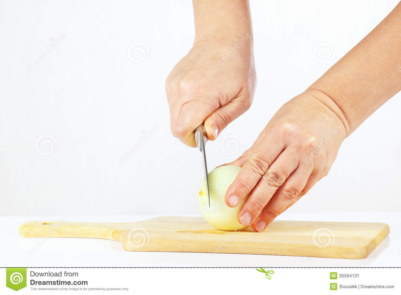 Hand With A Knife Cuts Raw Onion Stock Image - Image: 35594131