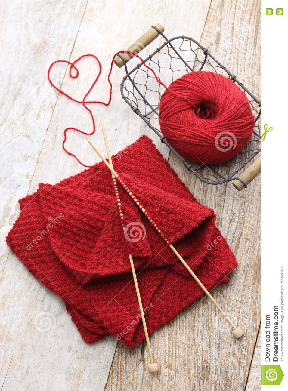 Cartoon Knitting Needles : Hand knitted red scarf and heart shaped thread royalty