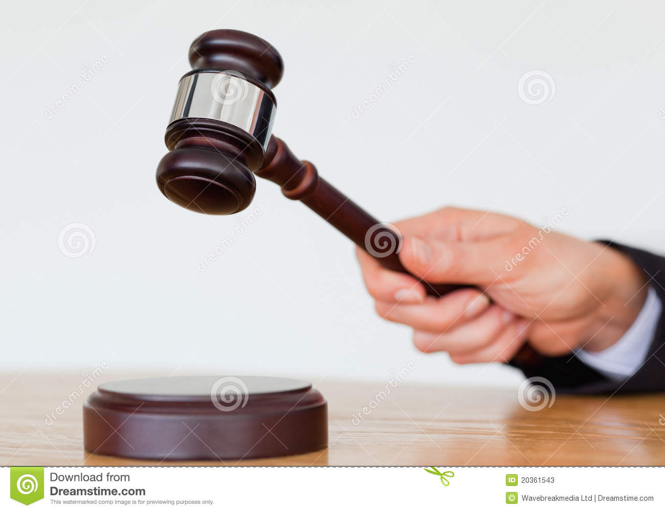 Hand knocking a gavel