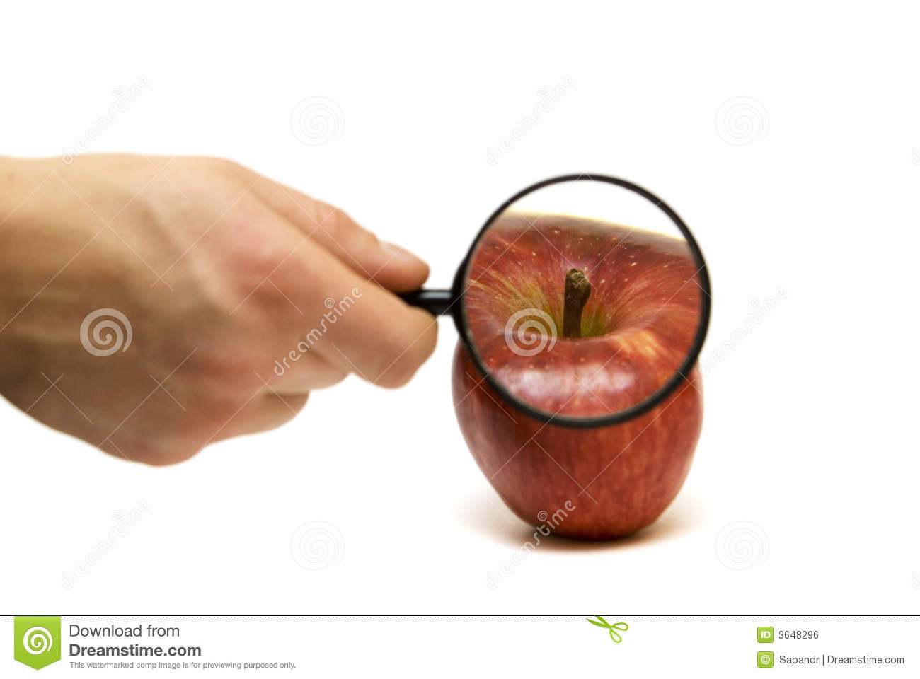 Hand with lens and the apple