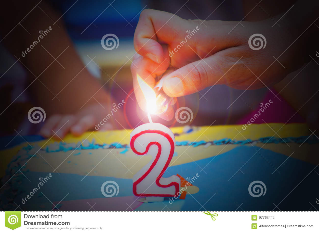 Hand With A Lighter About To Fire Two Years Birthday Candle Jp