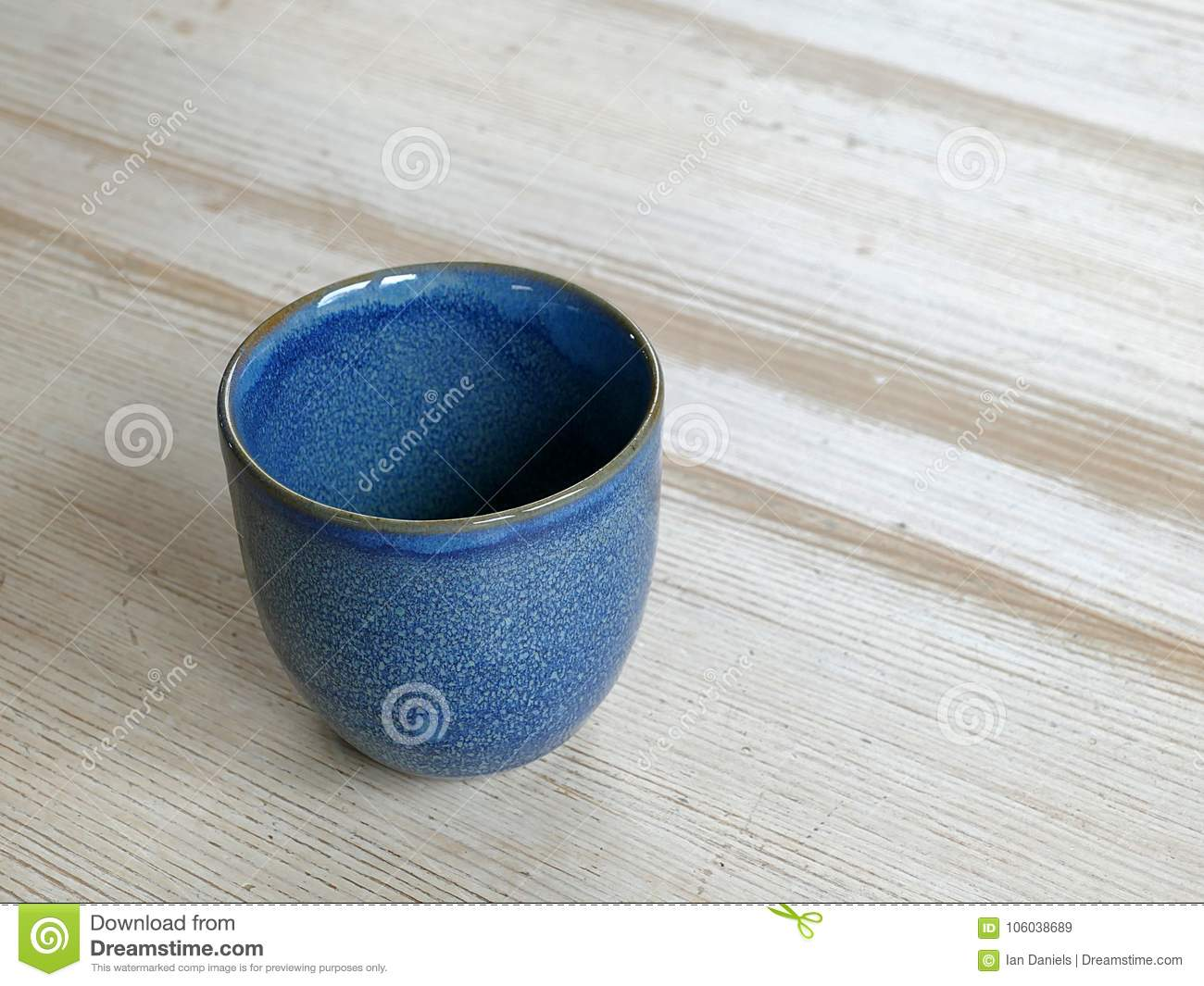 Hand made blue coffee cup on a wooden table