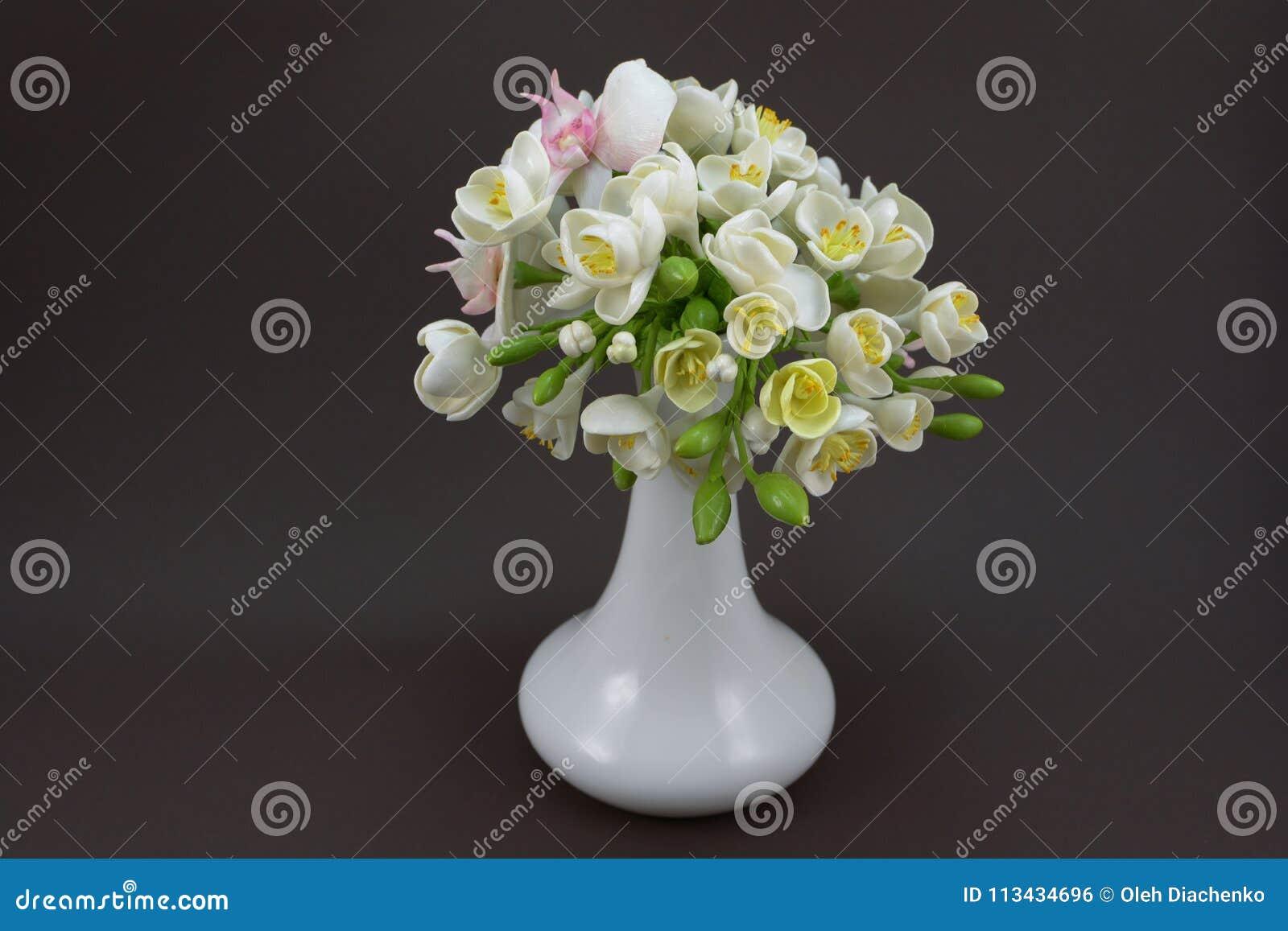 Hand made polymer clay flower bouquet in a white vase on a dark download hand made polymer clay flower bouquet in a white vase on a dark stock photo izmirmasajfo