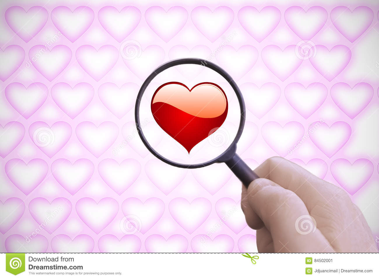 Hand With A Magnifying Glass  Looking For Love  Stock Image - Image