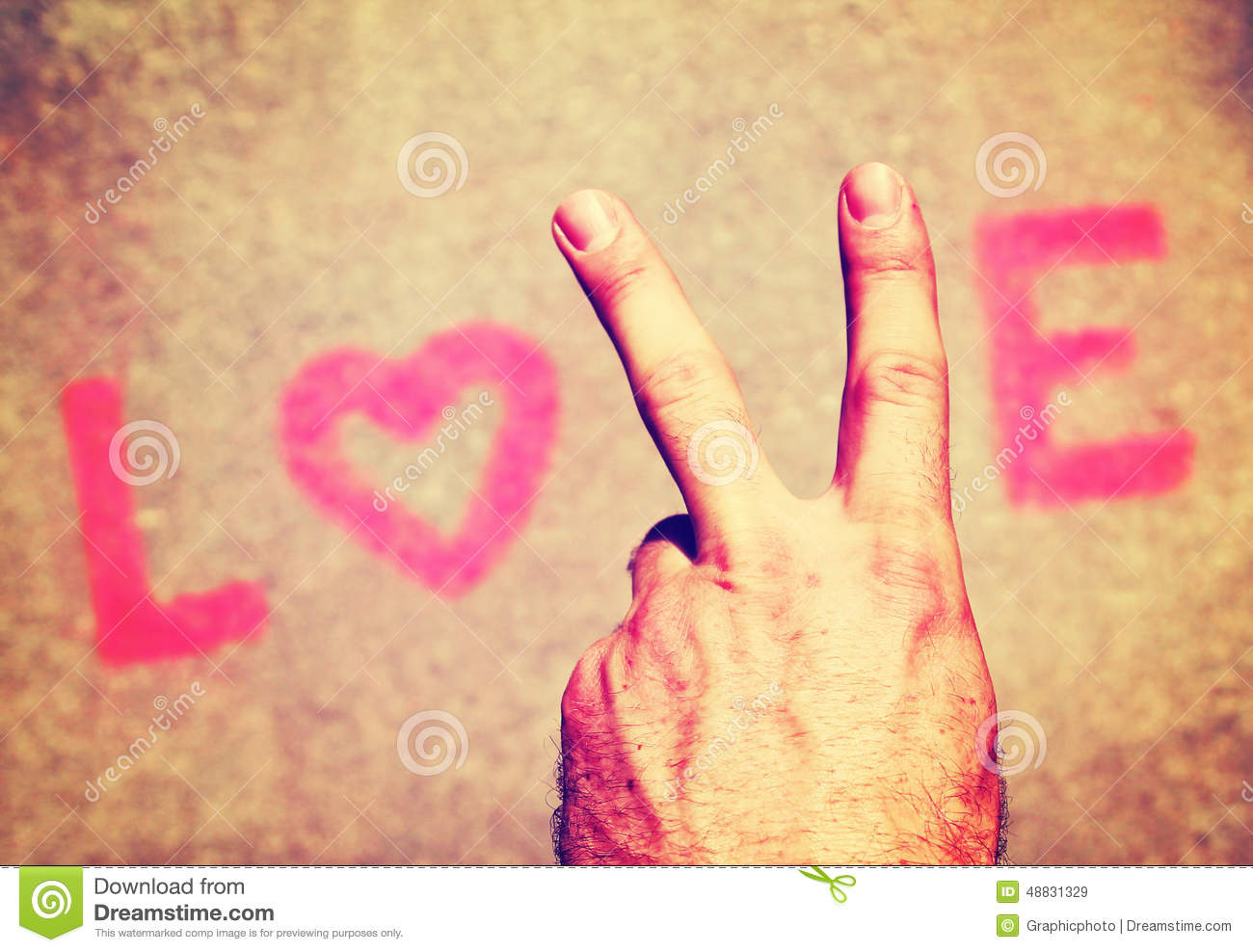 A Hand Making Peace Sign For The Letter V In Word Love