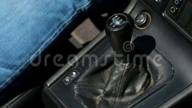 Hand of male car driver shifting gears while driving auto, cheap taxi  service