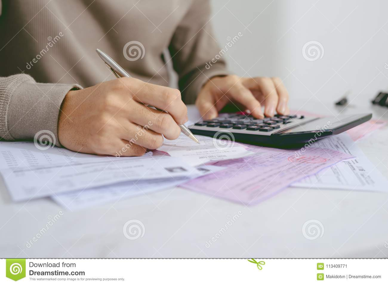 Hand man doing finances and calculate on desk about cost at home