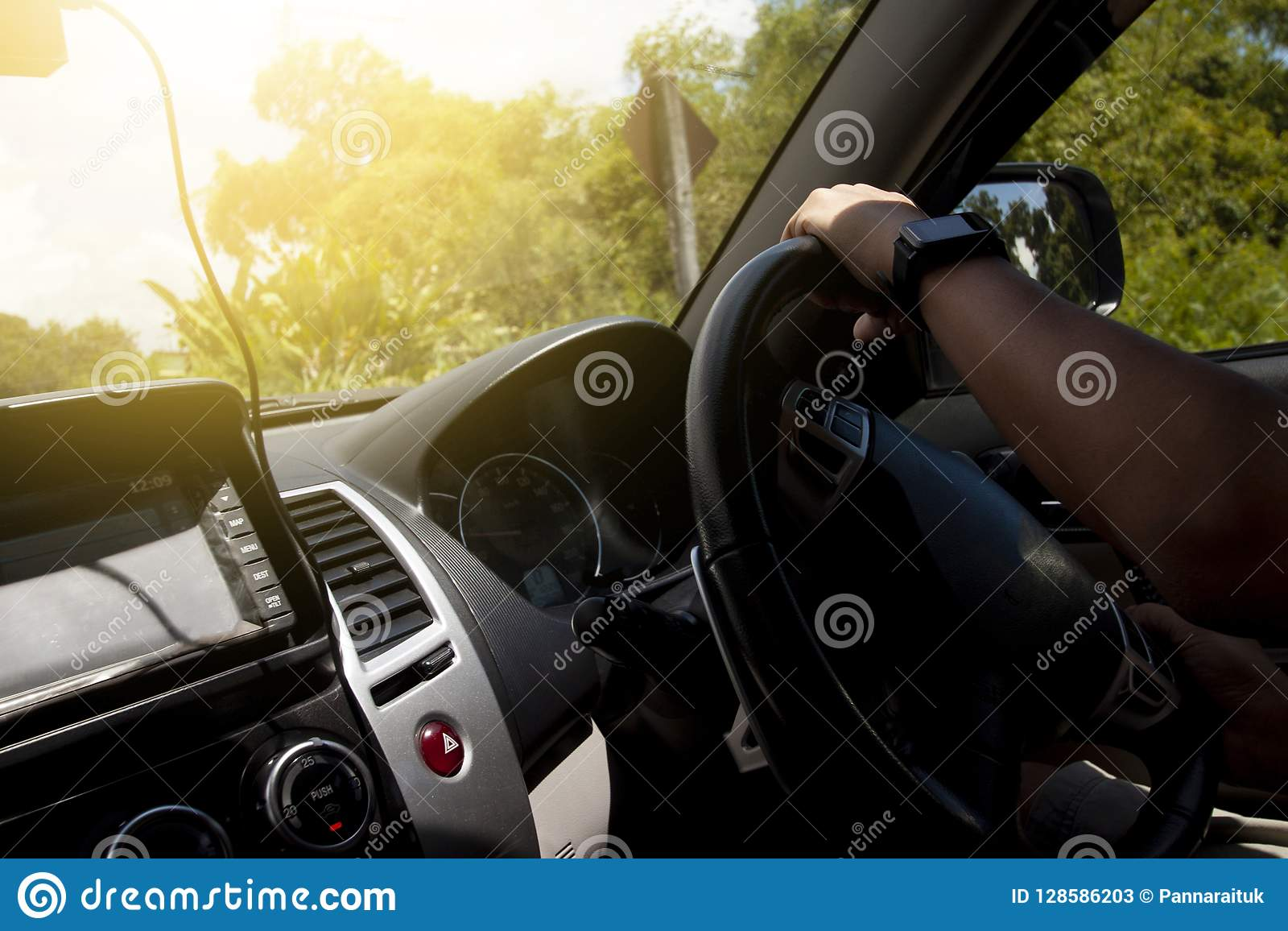 Hand of man driving inside car.