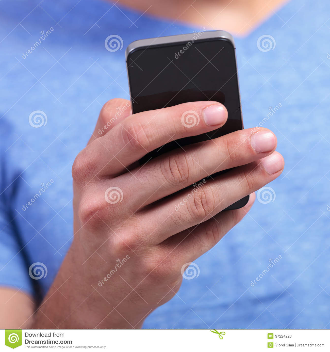 Hand Of A Man Holding A Smartphone Stock Image - Image of ...