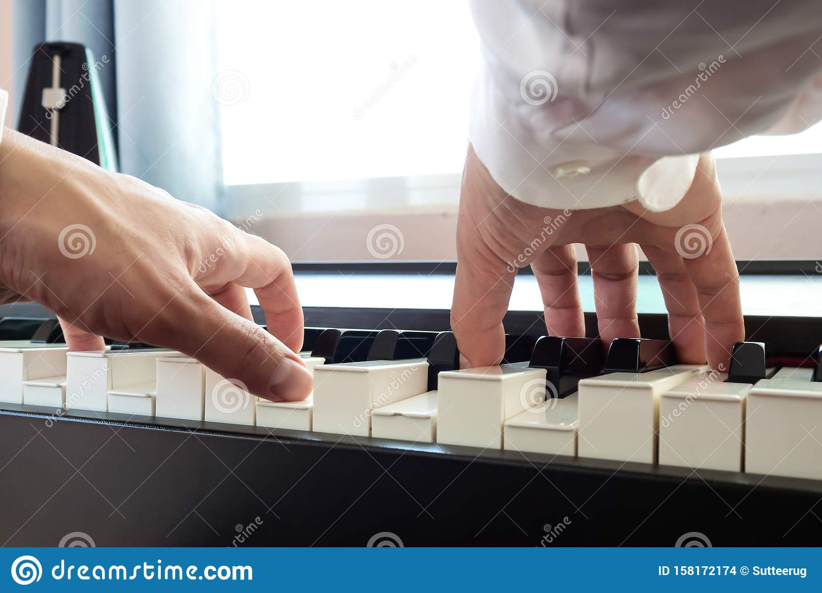 Hand man playing piano. Low angel view. Classical music instrument