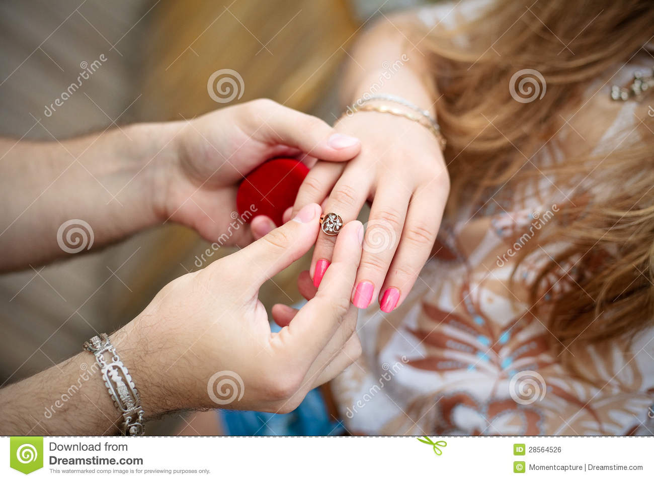 A Hand Of A Man Putting A Ring On The Girl\'s Finger Stock Photo ...