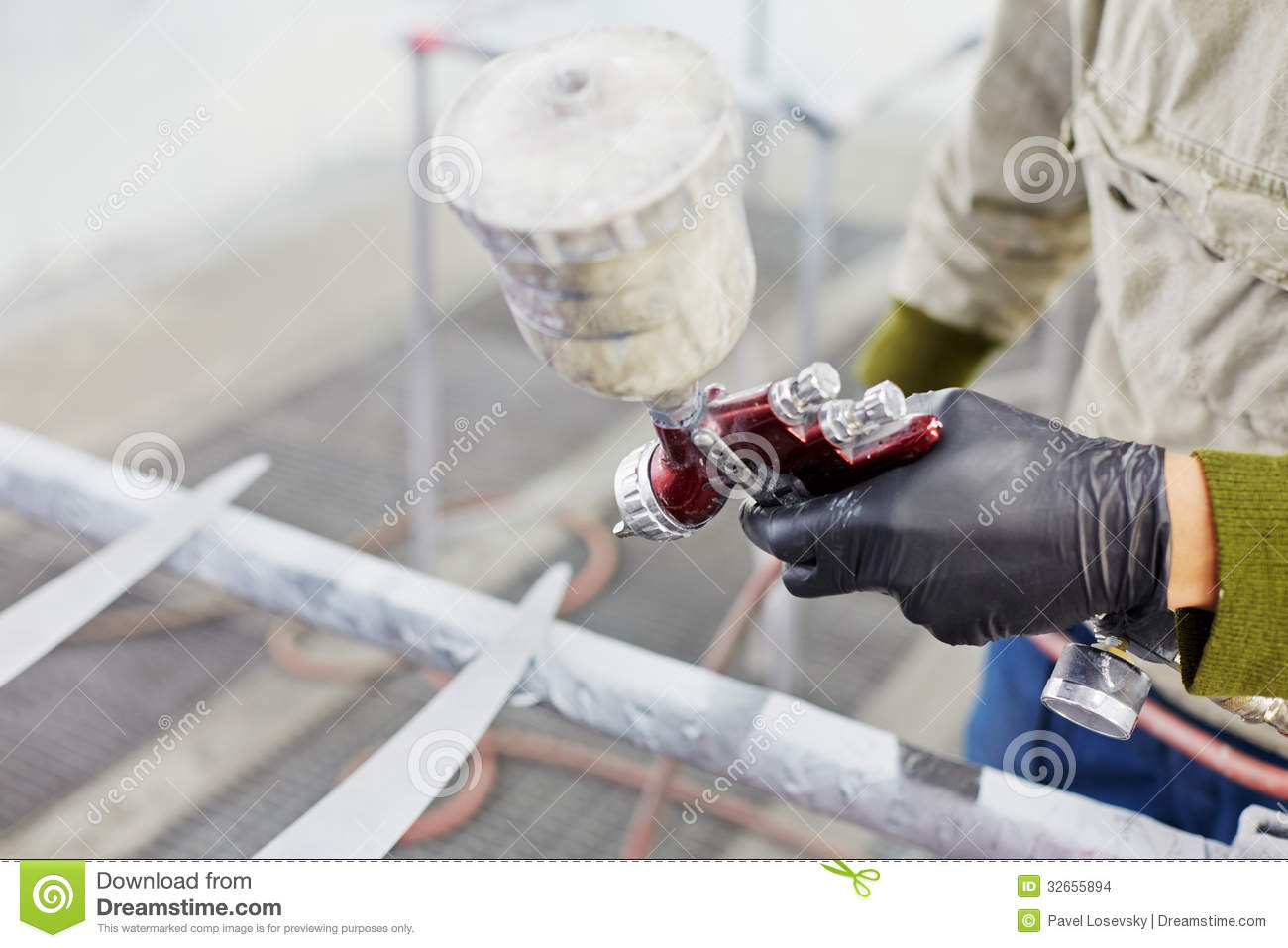 hand of man with spray paint gun painting car details. Black Bedroom Furniture Sets. Home Design Ideas