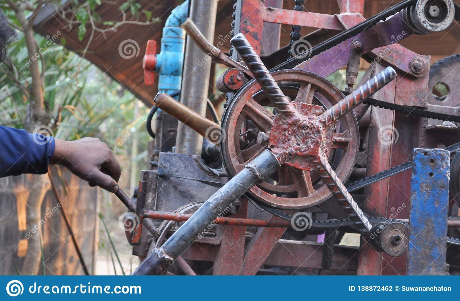 Hand of man working with old machine