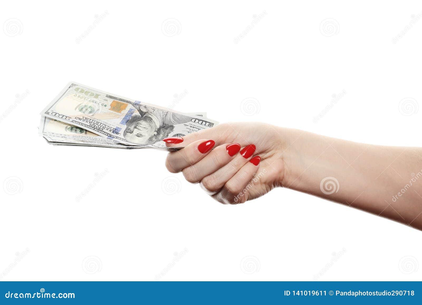 Hand med pengar som isoleras på en vit bakgrund