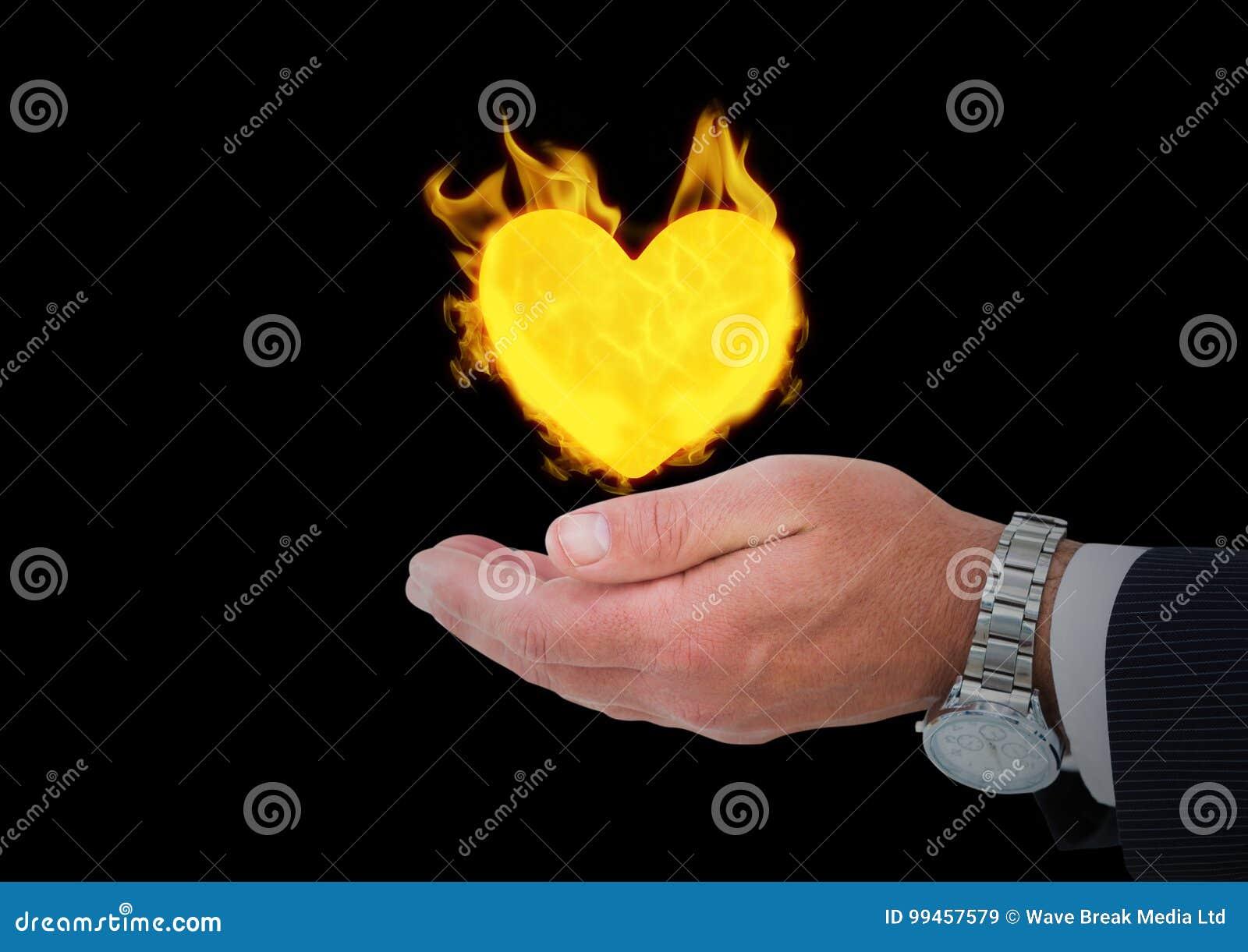 Hand met het pictogram van de hartbrand over Zwarte achtergrond