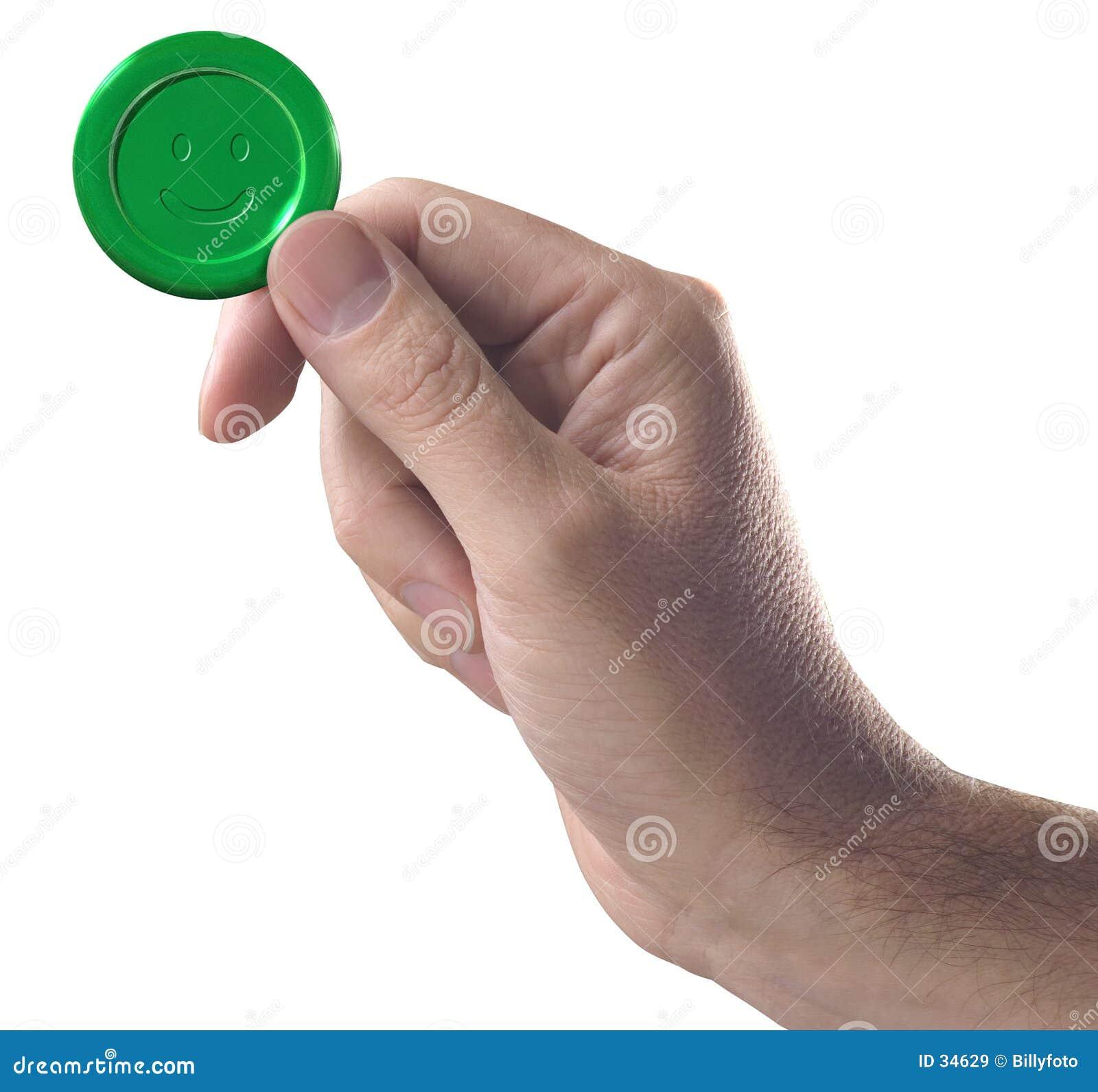 Hand mit grüner Taste