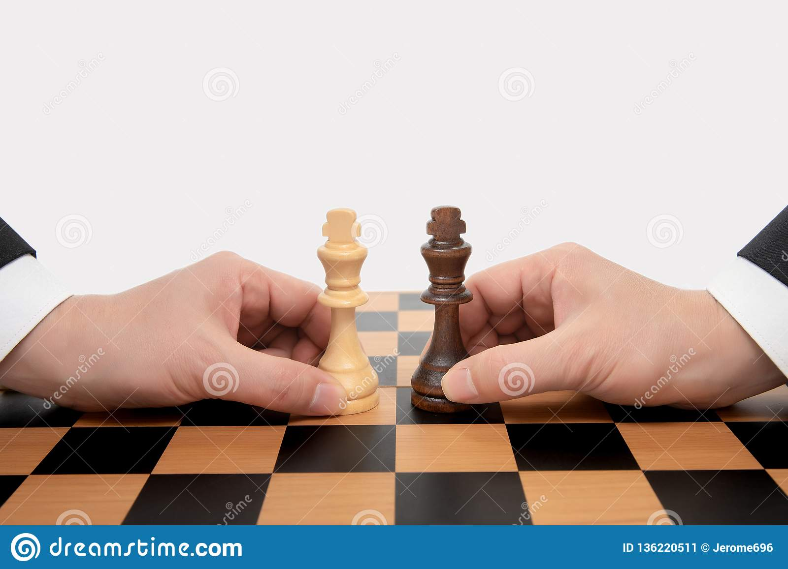 Hand of a moving businessman holding a king chess piece. Business Negotiation Concept