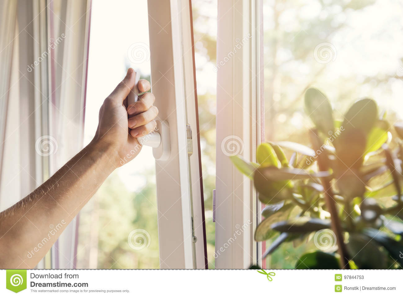 hand open plastic pvc window at home