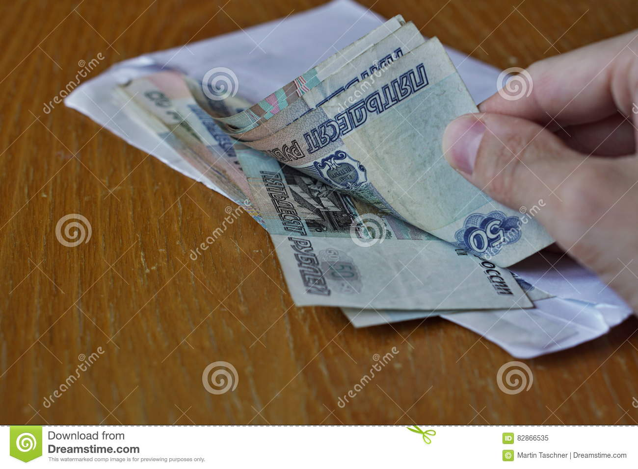 Hand Opening An Envelope Full Of Russian Currency Russian Ruble Rub