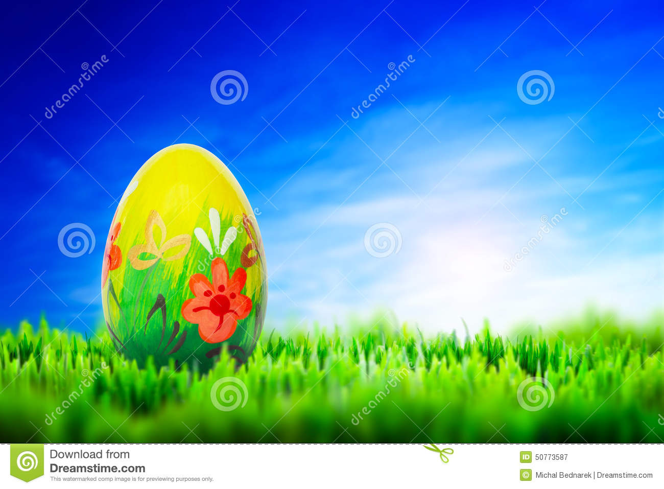 Hand painted Easter egg on grass. Spring pattern
