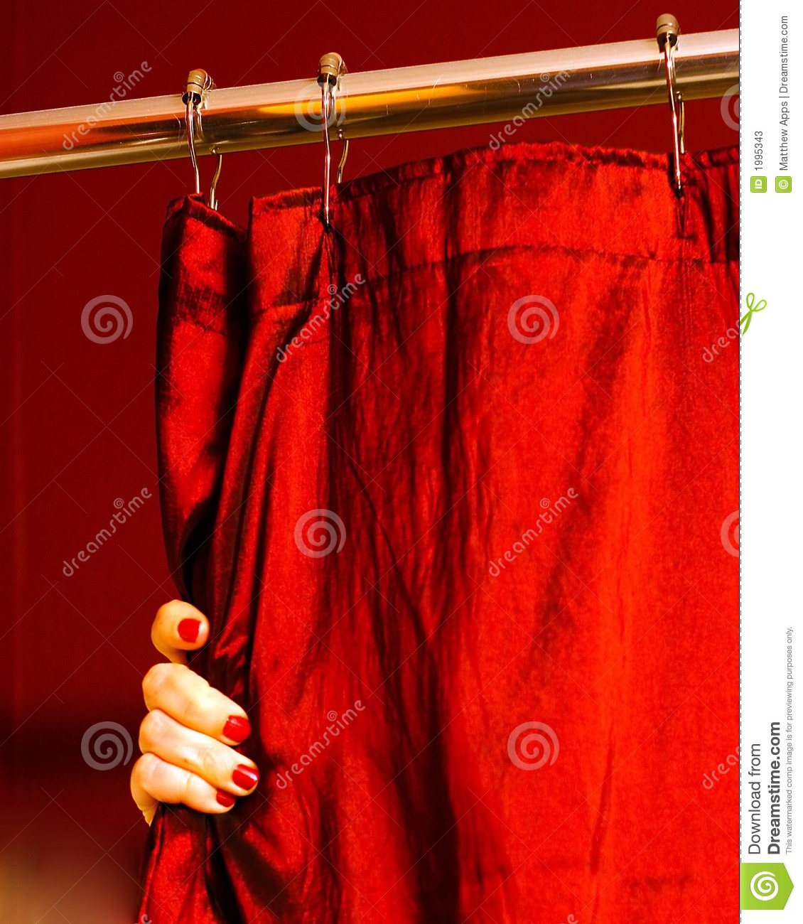 A Hand With Painted Finger Nails Holding A Red Shower