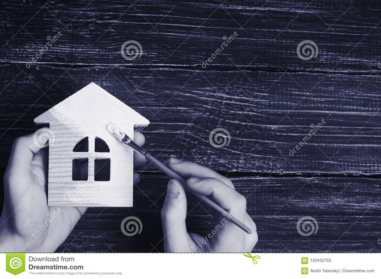 Hand paints a house. Concept of repair, hobby, work. Repair