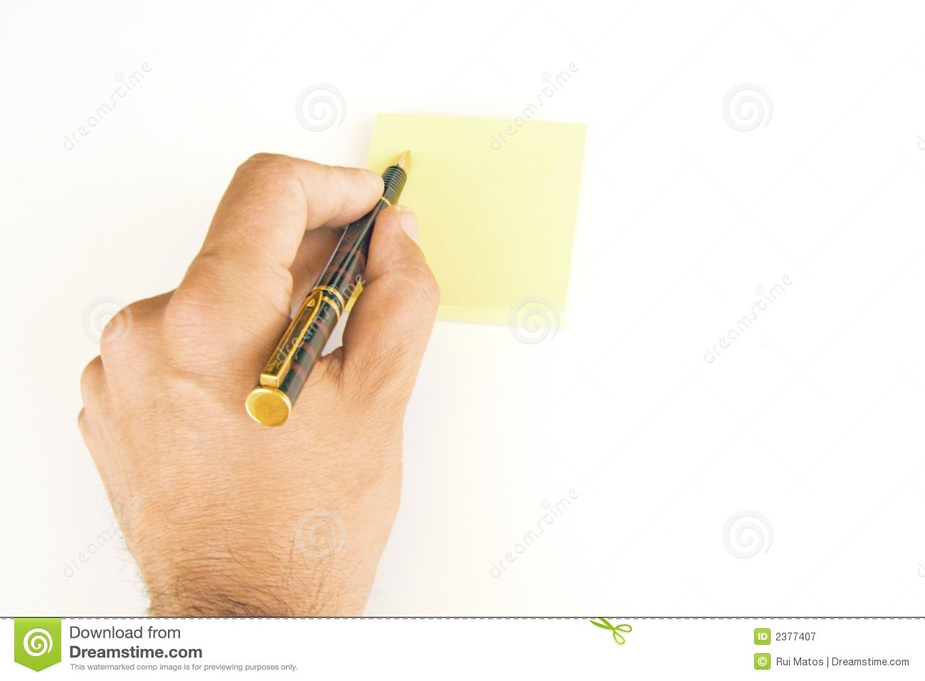 Hand With Pen and Post-it