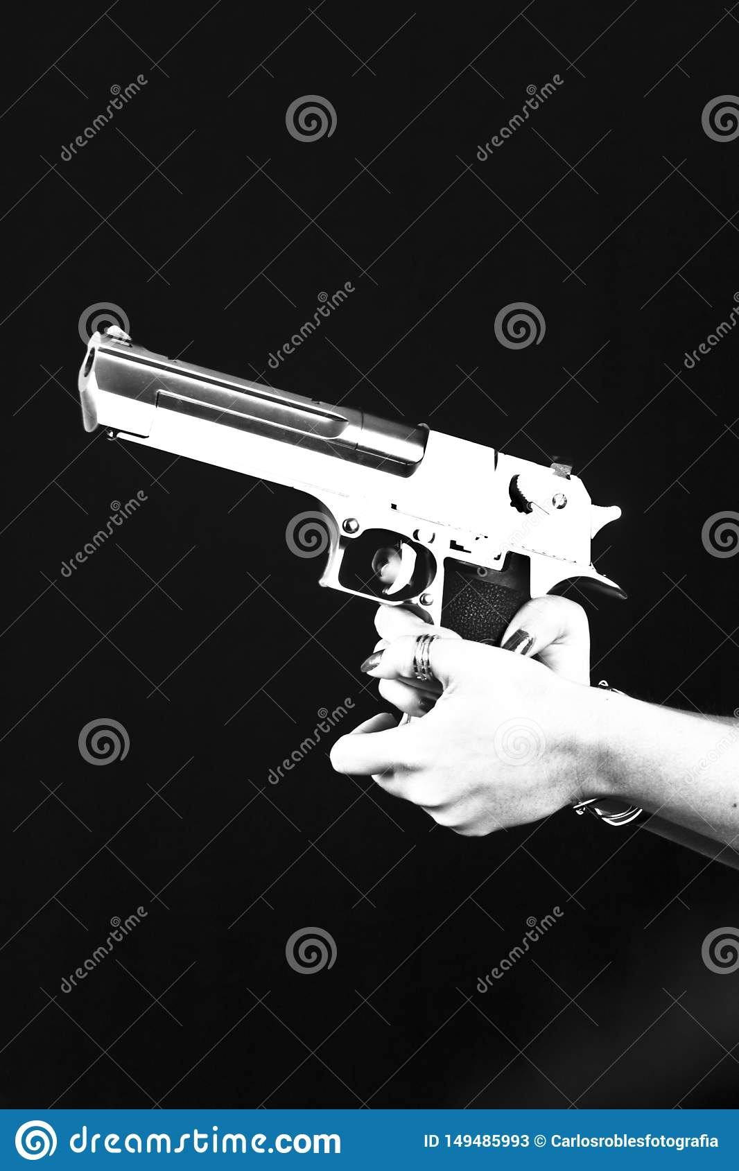 Hand with pistol on