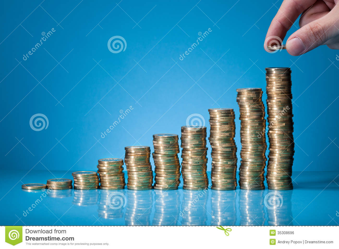 Hand Placing Coin On Stack Of Coins Stock Photo Image Of Gold