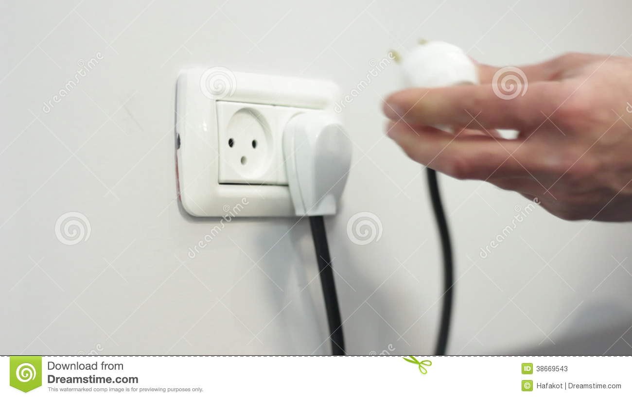 Hand Plugin Electric Wire To A Socket In A Wall Stock Video Footage ...