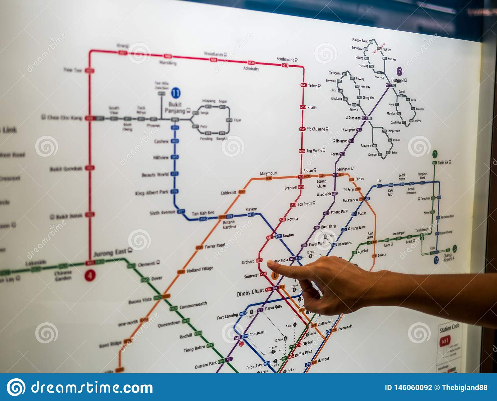 To Subway Map.Hand Pointing To A Subway Map In Singapore Editorial Photography