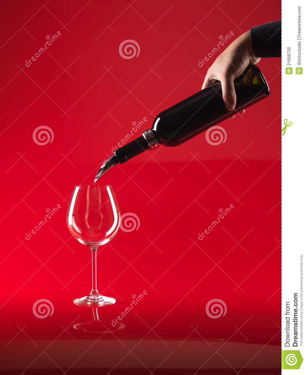 Hand Pouring Wine In Glass From Bottle Stock Photography ...