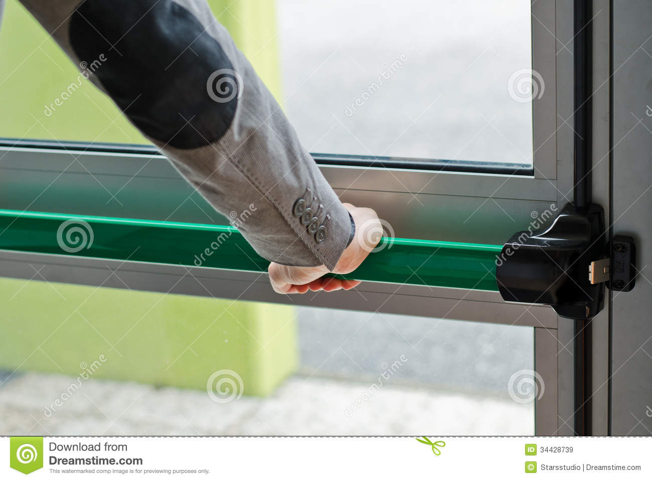 Hand Pressing Panic Push Bar To Open Door Stock Image
