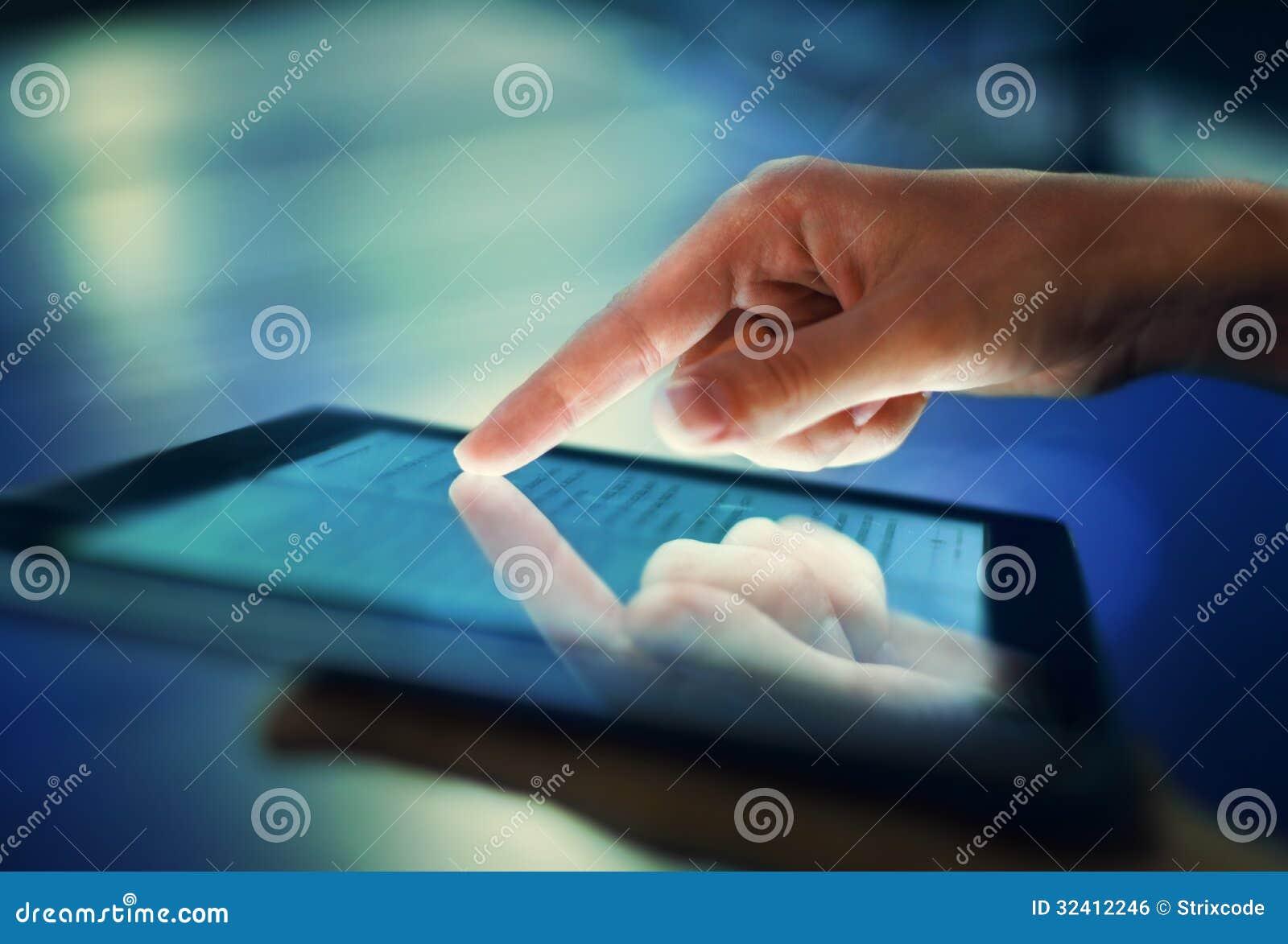 Hand pressing on screen digital tablet