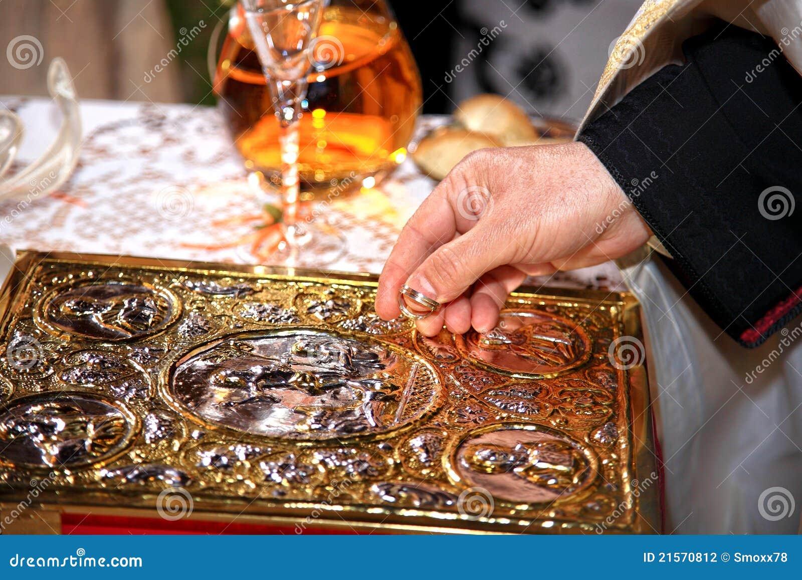 Priest Blessing Wedding Rings