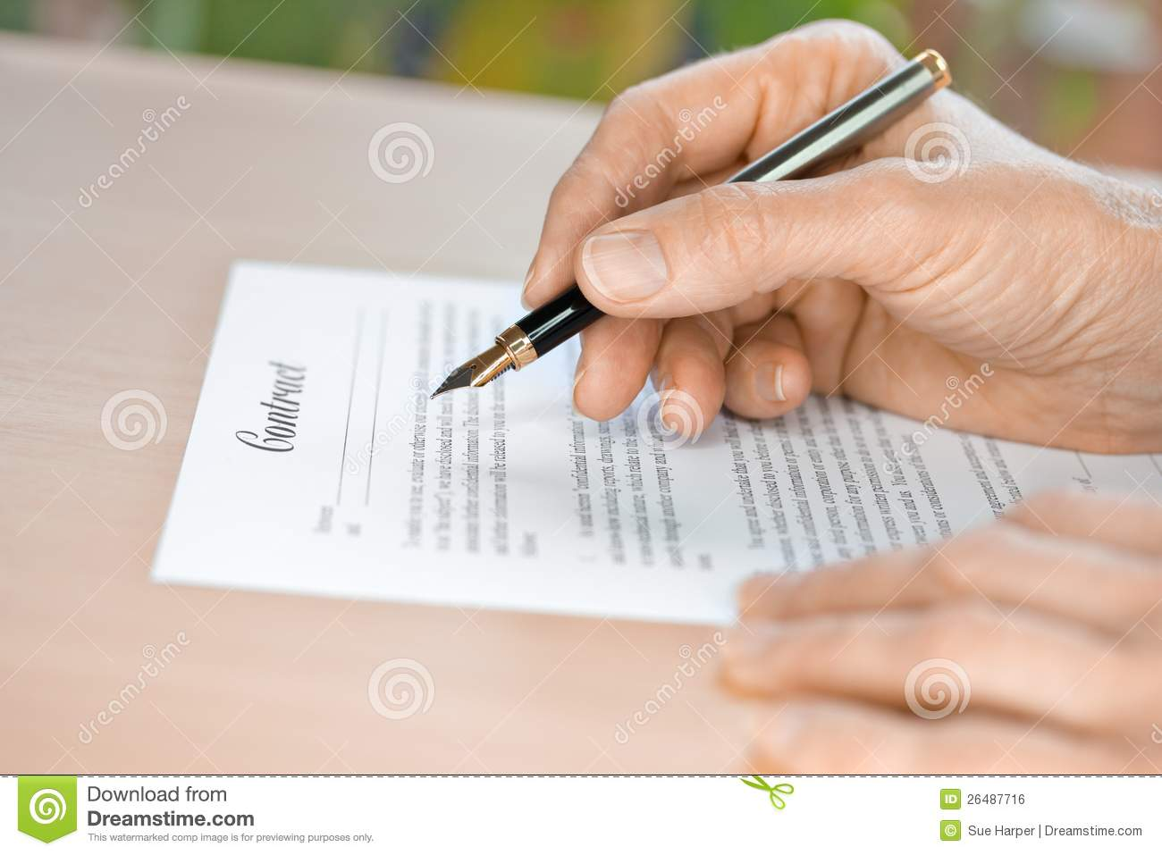 hand pen proofreading a resume by laptop royalty stock hand proofreading a contract fountain pen royalty stock image