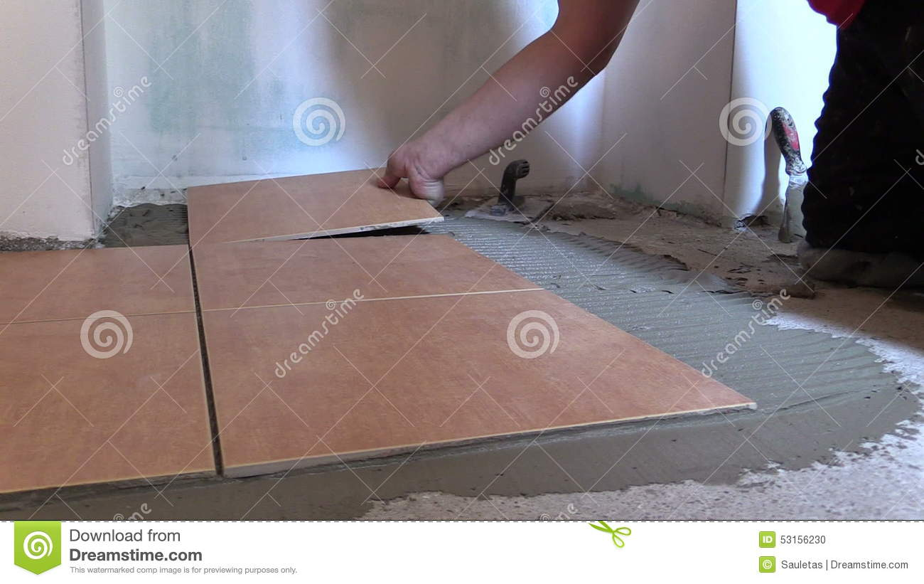 Hand put ceramic tile on cement glue at home floor stock footage hand put ceramic tile on cement glue at home floor stock footage video of architecture glue 53156230 dailygadgetfo Gallery
