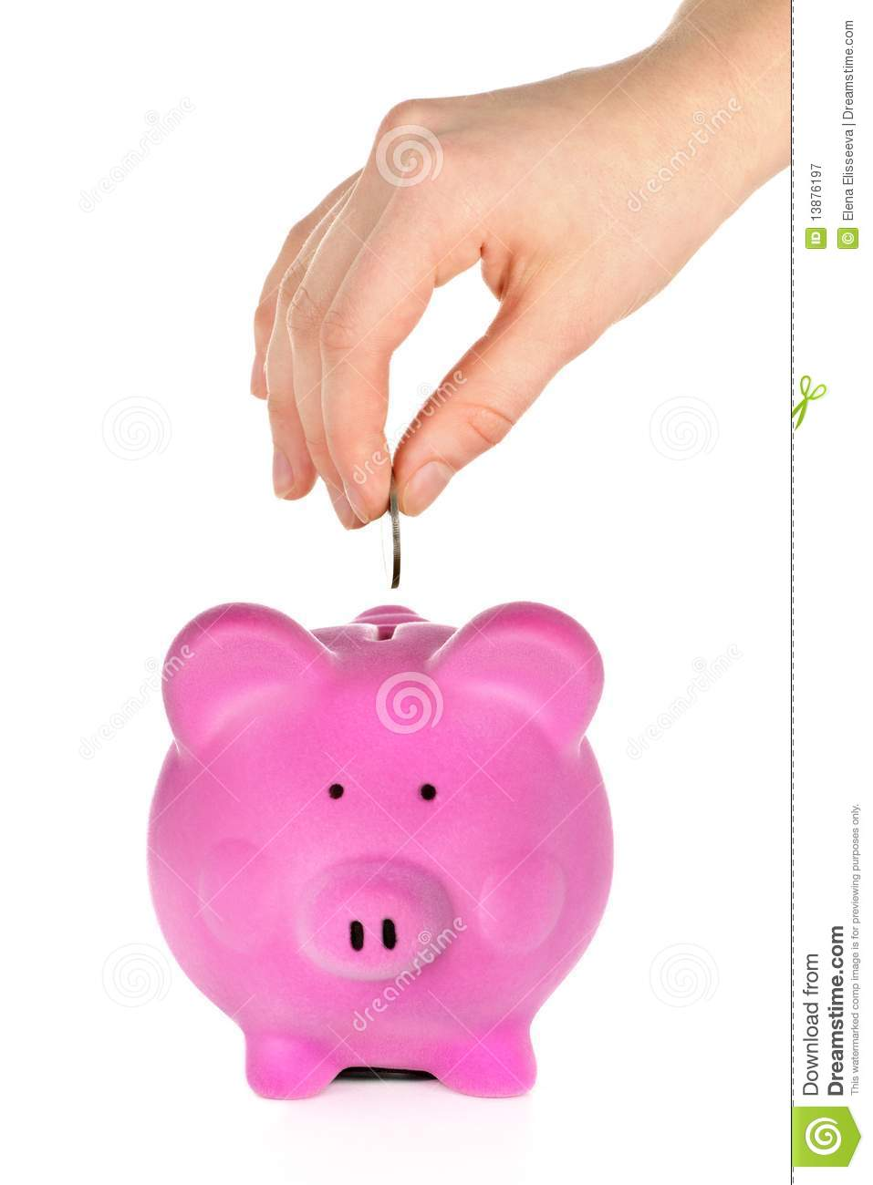 Hand Putting Coin In Piggy Bank Royalty Free Stock